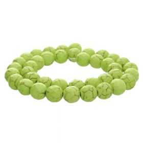 Howlite / faceted round / 12mm / spring green / 30pcs