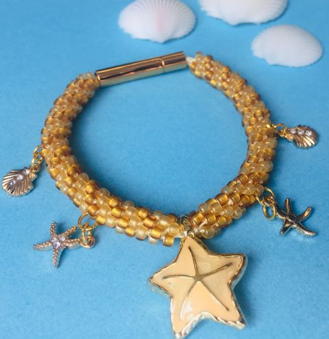 How to make a Kumihimo bracelet with beads and charms - jewellery making tutorial